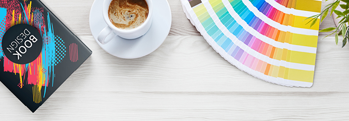 desk with book and colorful swatches